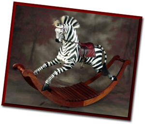 Zebra wooden rocking horse by Al Carr.